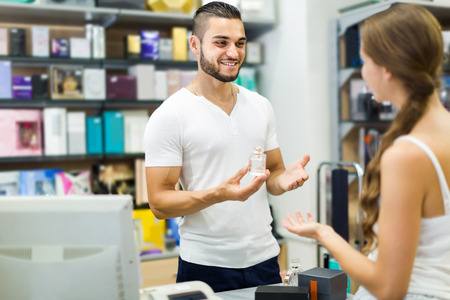 customer assistant: european client at shop paying at cash register desk Stock Photo