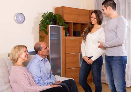 boyfriend: Happy young man showing his future wife to  parents