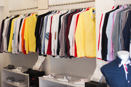 hangers: Fashionable apparel store with men shirts on hangers