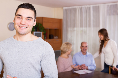 hypothec: adult guy and big family with agent Stock Photo