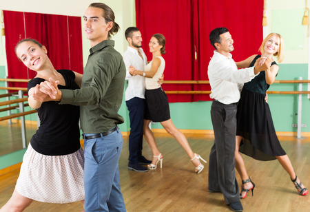 unprofessional: happy spanish men and women having dancing class in studio