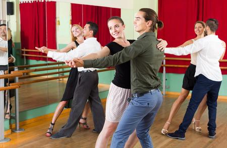 unprofessional: european men and women enjoying of tango in class
