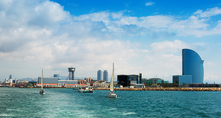barcelona: BARCELONA, SPAIN - JULY 6, 2014: Day view of Port Vell from sea side. Barcelona, Spain. Editorial