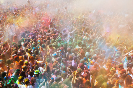 trituration: BARCELONA, SPAIN - APRIL 12, 2015: Many happy people during   Festival de los colores Holi at Barcelona. Holi is traditional holiday  of Indian culture