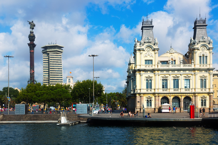 spain: BARCELONA, SPAIN - JULY 6, 2014: Columbus statue and Port Vell in Barcelona, Spain.  It is the oldest and largest port the city