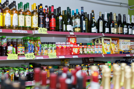 wine trade: BARCELONA, SPAIN - MARCH 22, 2015: Shelves with wine and soft drinks at beverage section of average Polish supermarket in Barcelona.