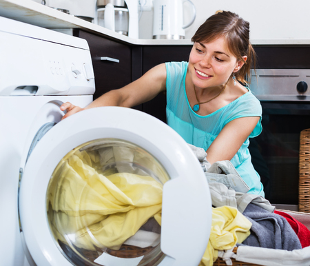 without clothes: Satisfied woman enjoying clean clothes without stains after laundry Stock Photo