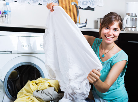 without clothes: Young woman enjoying clean clothes without stains after laundry