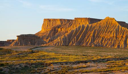 navarra: cliffs at semi-desert landscape of bardenas reales natural park  in sunny morning. Navarra, Spain