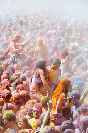trituration: BARCELONA, SPAIN - APRIL 12, 2015: Happy people during   Festival of  Holi Editorial
