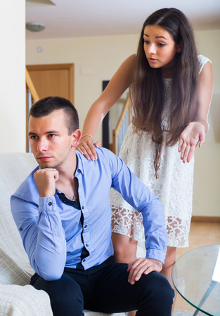 enmity: Sad young spouses having bad argue at home