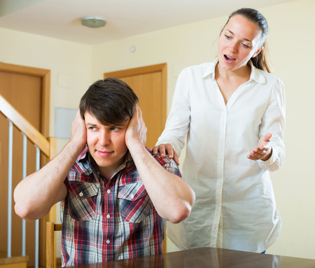 squabble: Upset guy and woman during conflict at home