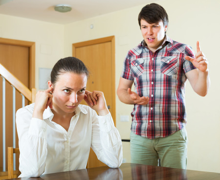 variance: Despair woman and sad guy during conflict in living room at home Stock Photo