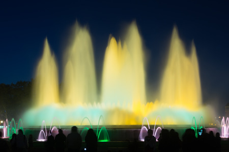 gazer: Evening view at colorful vocal fountain Montjuic show in Catalonia. Spain