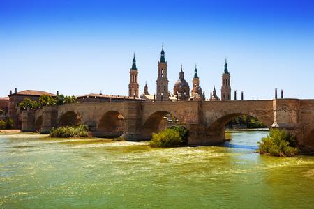 zaragoza: ancient stone bridge over Ebro river in Zaragoza. Aragon