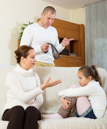 fracas: Angry parents berating daughter in living room at home