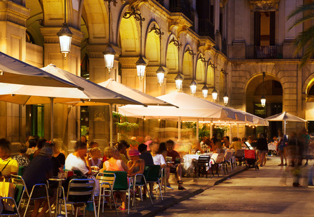 restaurants at Placa Reial in summer night. Barcelona, Catalonia
