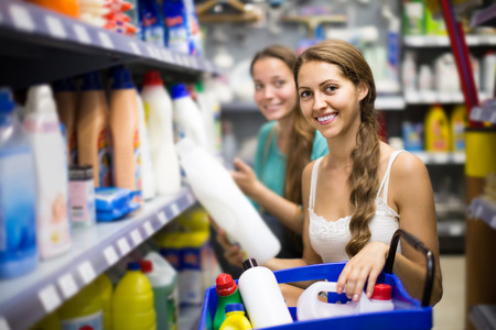 vend: spanish people buying detergents for house in the shopping mall