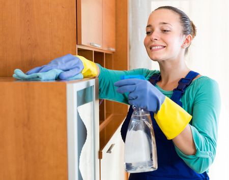cleaner: happy professional european cleaner  cleaning the office