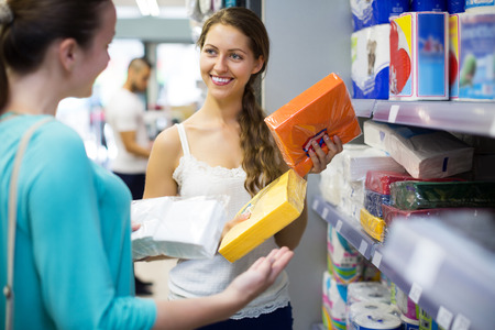 sudarium: Happy girl buying napkins for kitchen in the shopping mall