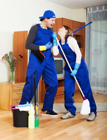 cleaning team: Playful cleaning team is ready to work in the flat Stock Photo