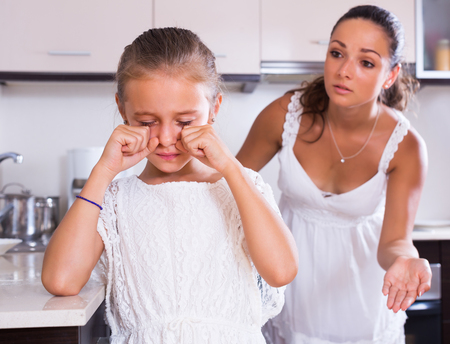 shaming: Crisis of motherhood: woman preaching unhappy daughter