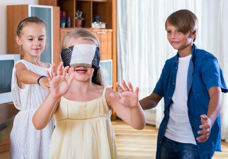 blind man: smiling european  children playing at Blind man bluff indoors