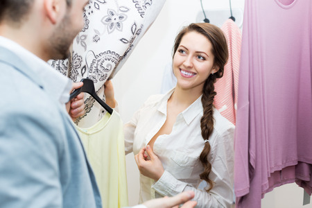 spouses: Happy spouses standing at boutique changing cubicle Stock Photo