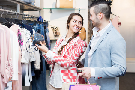 spouses: Happy young spouses while shopping at boutique Stock Photo