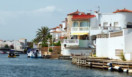 waterways: EMPURIABRAVA, SPAIN - MAY 14, 2015: Homes and canals at residential marina. Empuriabrava  is  largest residential marina in Europe with some 24 km of navigable waterways