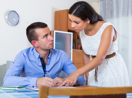 sad couple: Irritated unhappy spouses having serious conversation about family budget