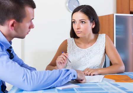 spouses: Irritated young spouses having serious conversation about family budget at home Stock Photo