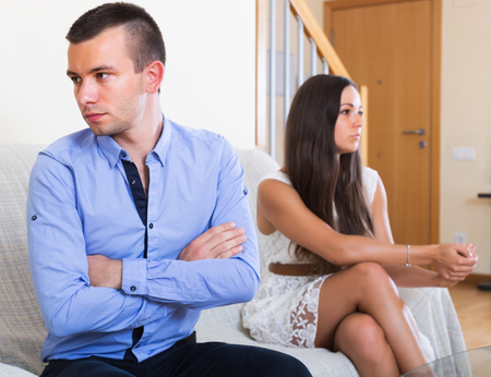 spouses: Angry spouses having bad argue in livingroom at home Stock Photo