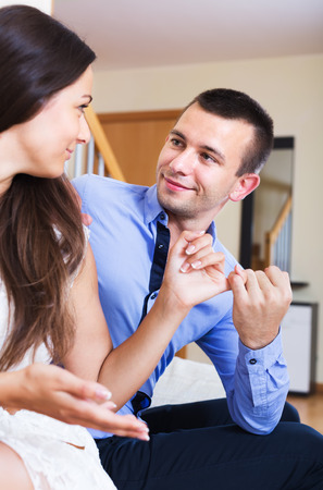 spouse: Smiling spouse forgiving partner for words and actions at home Stock Photo