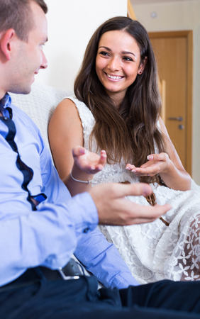 anecdote: Relaxed american husband and wife joking about something at home