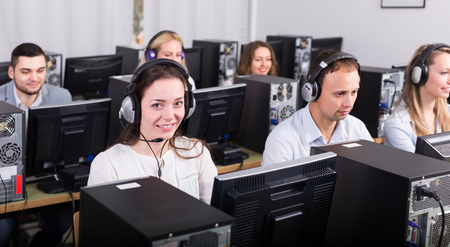 successful employees of technical support line receiving calls