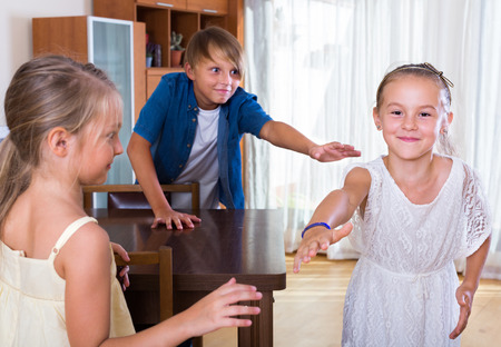 romp: russian children playing romp game Touch-last at home Stock Photo