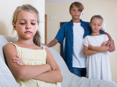 amorousness: First amorousness: sad russian girl and couple of kids apart indoors Stock Photo