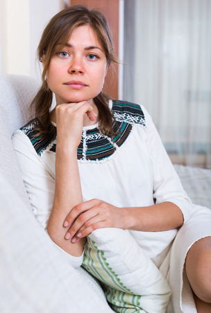 miserable: Portrait of miserable young woman with hanging look Stock Photo