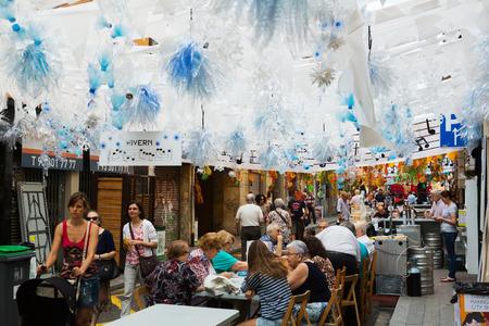 festa: BARCELONA, SPAIN - AUGUST 16, 2015:  Gracia Festa Major in Barcelona, Catalonia. Decorated streets of Gracia district. Winter theme