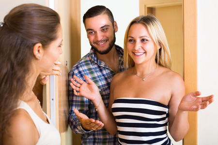 mate married: Happy adult couple visiting female friend at her new apartment
