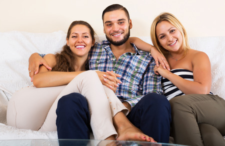 polygamy: Portrait of two charming girls with attractive boyfriend Stock Photo