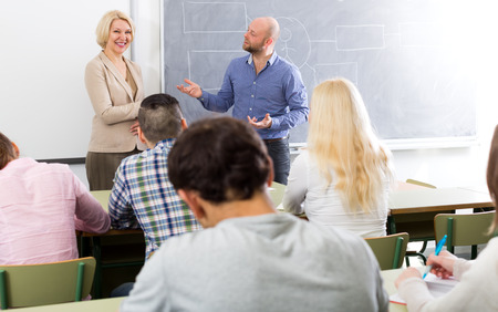 normal school: Professionals and happy adult coach at training session for employees Stock Photo