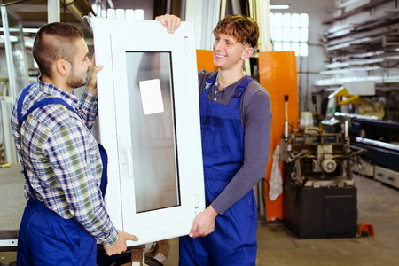 toolroom: Two men  inspecting  windows at modern plant