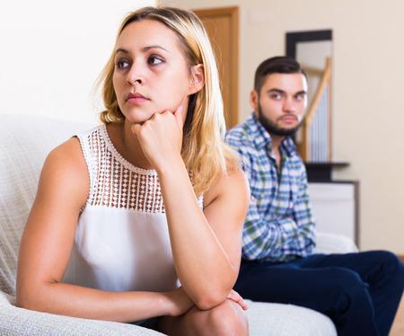 misunderstanding: Frustrated man and young woman having misunderstanding indoors