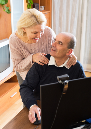 global retirement: Old husband shows how to use skype to wife at home