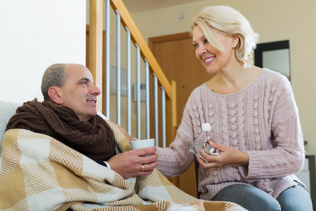 taking a wife: Ill pensioner is sitting at home with his wife and hot tea