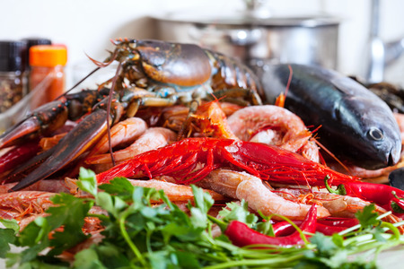 lobster pots: Still life with fresh raw seafoods  in domestic kitchen