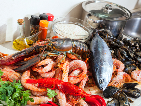 lobster pots: Fresh lobster and other seafood  in home kitchen