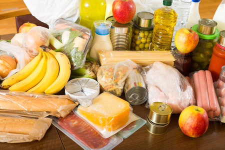moderate: Provision with vegetables and meat for moderate family at table in home Stock Photo